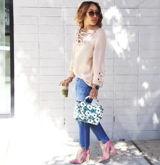 We're all seeking comfortwhen it comes to dressing up, and this combination of a beige knit oversized sweater and blue jeans isa practical example of that. Wearing a pair of pink suede pumps is an easy way to add extra flair to your getup. Rest assured, this combination is the answer to all of your spring style struggles.