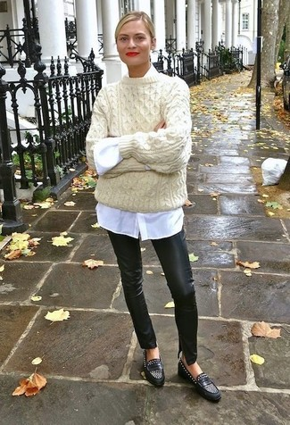 This combination of a beige knit oversized sweater and The Row Leather Straight Leg Pants spells comfort and definitely sass. And it's a wonder what a pair of black studded leather loafers can do for the look. As you imagine, this is also a kick-ass pick when spring arrives.