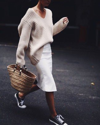 How to Wear a White Pencil Skirt: A beige knit oversized sweater and a white pencil skirt are true must-haves if you're picking out an off-duty wardrobe that matches up to the highest style standards. Black and white low top sneakers will add a playful feel to this look.