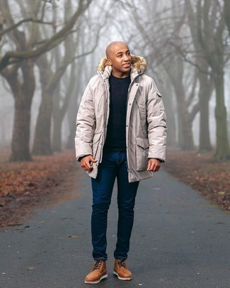 Men's Outfits 2020: A beige parka and navy jeans paired together are a savvy match. Finishing with tobacco leather desert boots is a simple way to add a little depth to this ensemble.