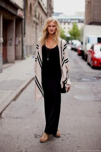 Beige Shawl Outfits: A black maxi dress and a beige shawl are a combo that every cool girl should have in her casual wardrobe. Tone down the casualness of your outfit by sporting tan leather wedge sandals.
