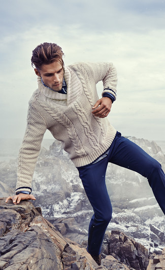 How to wear: beige shawl-neck sweater, blue plaid long sleeve shirt, navy chinos, dark brown leather casual boots