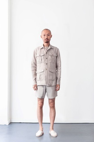 Men's Outfits 2020: When you need to feel confident in your ensemble, make a beige shirt jacket and grey shorts your outfit choice. The whole ensemble comes together perfectly when you complement this outfit with white canvas espadrilles.