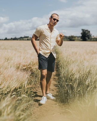 Black Shorts Outfits For Men: If you feel more confident wearing something functional, you'll love this dapper pairing of a beige vertical striped short sleeve shirt and black shorts. If you're wondering how to finish, a pair of white and black canvas low top sneakers is a savvy pick.