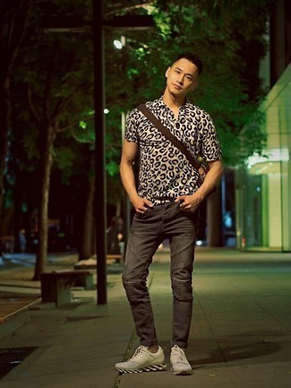 Charcoal Jeans Outfits For Men: On days when comfort is a must, opt for a beige leopard short sleeve shirt and charcoal jeans. Bring an easy-going vibe to this getup by sporting a pair of white athletic shoes.