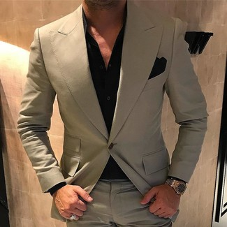 How to wear: beige suit, black dress shirt, black pocket square, gold watch