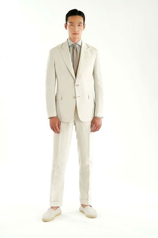 A beige suit and a grey dress shirt is a greatcombo for you to try. Espadrilles will add a more relaxed feel to your look. There are plenty of ways to look cool and survive the blazing hot weather, and this here is one of them.
