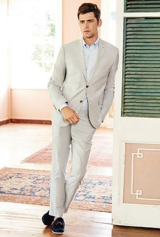How to Wear Navy Suede Tassel Loafers: A beige suit and a light blue dress shirt are absolute wardrobe heroes if you're picking out a sharp closet that matches up to the highest menswear standards. Navy suede tassel loafers will add a playful touch to an otherwise mostly dressed-up ensemble.