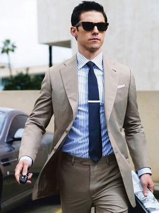 How to wear: beige suit, white and blue vertical striped dress shirt, navy knit tie, black sunglasses
