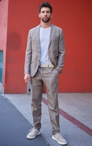 How to Wear Beige Canvas Low Top Sneakers For Men: A beige linen suit and a white crew-neck t-shirt matched together are a perfect match. To give your overall outfit a more casual feel, why not add beige canvas low top sneakers to your ensemble?