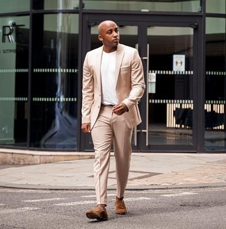 Beige Suit Outfits: Reach for a beige suit and a white crew-neck t-shirt to look polished but not particularly formal. Complement this ensemble with brown suede loafers to serve a little mix-and-match magic.