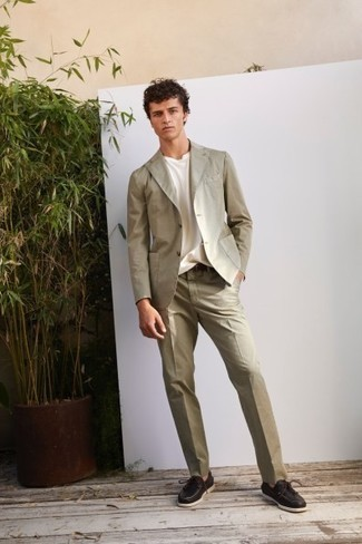Beige Suit Outfits: A beige suit and a white crew-neck t-shirt are the perfect base for an outfit. Don't know how to finish off? Complete your outfit with dark brown leather boat shoes for a more laid-back spin.
