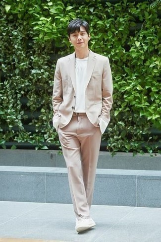 Beige Suit Outfits: For something on the semi-casual side, you can wear a beige suit and a white crew-neck t-shirt. Infuse a more casual feel into this getup by sporting a pair of white canvas low top sneakers.