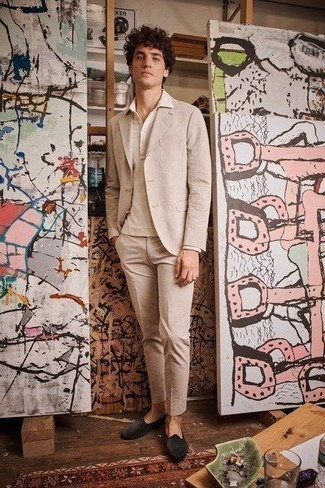 How To Wear a Suit With a Polo Neck Sweater: Rock a suit with a polo neck sweater for a sleek classy outfit. For times when this look looks all-too-dressy, play it down by finishing off with charcoal velvet loafers.
