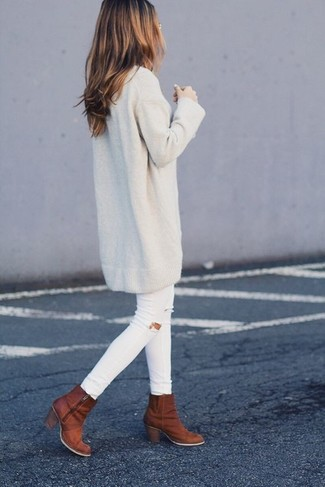 How to wear: beige sweater dress, white ripped skinny jeans, tobacco leather ankle boots