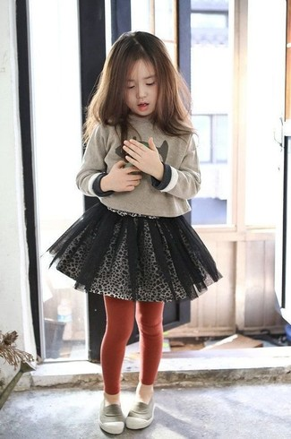 How to wear: beige print sweater, grey tulle skirt, grey loafers, red tights