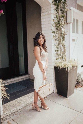 How to Wear a White Pencil Skirt: If it's comfort and functionality that you appreciate in a look, wear a beige tank and a white pencil skirt. Beige leather heeled sandals are guaranteed to bring an extra dose of style to your ensemble.