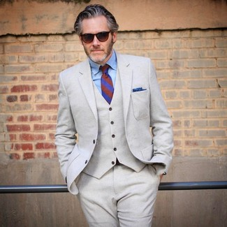 How to Wear a Blue Pocket Square In Spring: To achieve a relaxed ensemble with a twist, pair a beige wool three piece suit with a blue pocket square. This is a never-failing option for a cool outfit that will take you from winter to spring.