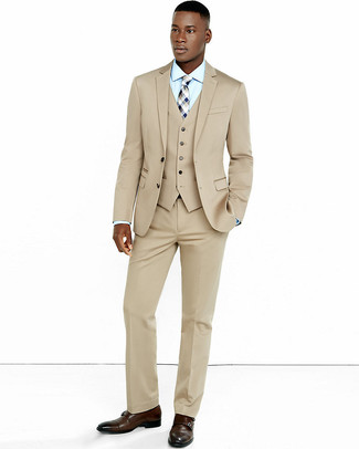 How to wear: beige three piece suit, light blue dress shirt, dark brown leather double monks, beige plaid tie