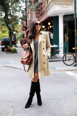 Wear a beige trenchcoat with a charcoal wool swing dress and you'll look like a total babe. Round off this look with black suede knee high boots.