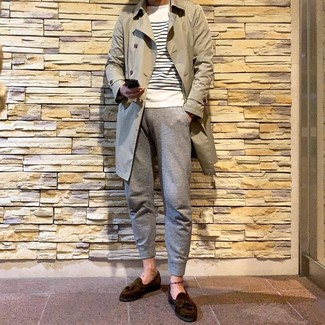 How to wear: beige trenchcoat, white and navy horizontal striped crew-neck sweater, grey sweatpants, dark brown suede tassel loafers