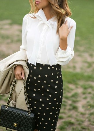 How to wear: beige trenchcoat, white button down blouse, black and white polka dot pencil skirt, black quilted leather crossbody bag