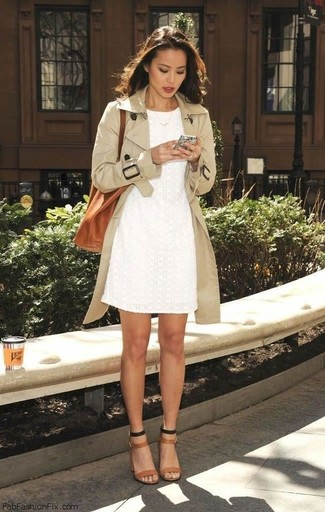 Pairing a beige trench with a white lace sheath dress is an on-point option for a day in the office. Camel leather heeled sandals are a good choice to complete the look.
