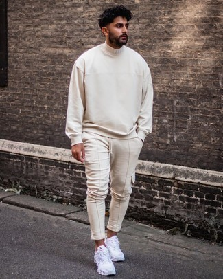 White Athletic Shoes Outfits For Men: This relaxed pairing of a beige turtleneck and beige cargo pants is super easy to pull together without a second thought, helping you look amazing and ready for anything without spending too much time searching through your wardrobe. And if you want to instantly play down your ensemble with shoes, introduce white athletic shoes to this look.