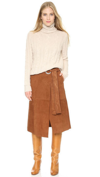 How to wear: beige turtleneck, brown suede midi skirt, tan leather knee high boots