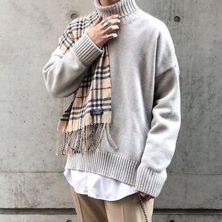 How to Wear a Beige Knit Turtleneck For Men: A beige knit turtleneck looks especially sophisticated when worn with khaki dress pants for an ensemble worthy of a stylish gent.