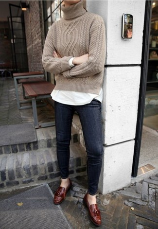 How to wear: beige knit turtleneck, white long sleeve t-shirt, navy skinny jeans, dark brown leather tassel loafers