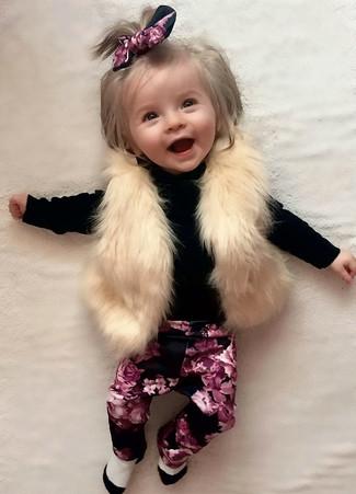 How to wear: beige fur vest, black sweater, black floral leggings, white socks