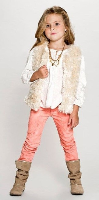 Consider dressing your daughter in a cream fur vest with dusty pink jeans for a trendy and easy going look. As for footwear your little one will love brown boots for this outfit.