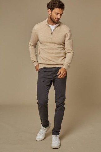White and Red Leather Low Top Sneakers Outfits For Men: A beige zip neck sweater and charcoal chinos are a nice outfit formula to keep in your menswear collection. Here's how to dial it down: white and red leather low top sneakers.