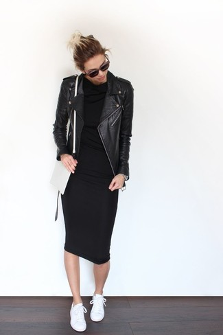 How to wear: black leather biker jacket, black bodycon dress, white low top sneakers, white leather crossbody bag