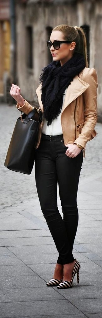 Stand out among other stylish civilians in a khaki leather biker jacket and black skinny jeans. Elevate this ensemble with black and white horizontal striped leather pumps.