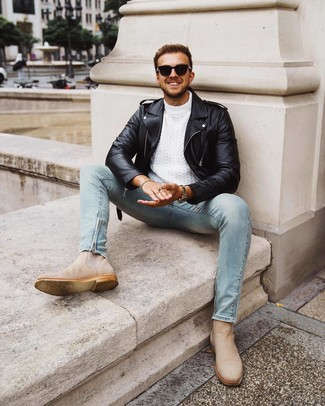How to Wear Beige Suede Chelsea Boots For Men: This contemporary combo of a black leather biker jacket and light blue skinny jeans can only be described as devastatingly dapper. Want to break out of the mold? Then why not add beige suede chelsea boots to the equation?