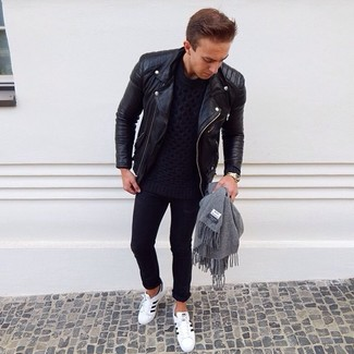 How to wear: black leather biker jacket, navy cable sweater, black skinny jeans, white and black leather low top sneakers