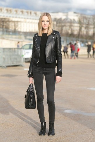How to wear: black leather biker jacket, black cable sweater, charcoal skinny jeans, black leather lace-up flat boots