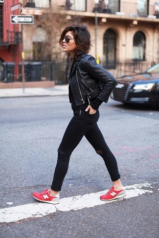 How to wear: black leather biker jacket, black cable sweater, black ripped skinny jeans, red low top sneakers