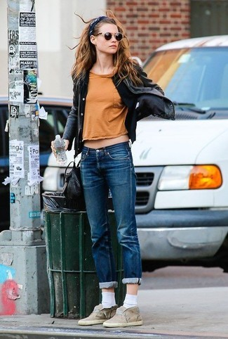 How to wear: black leather biker jacket, black cardigan, orange crew-neck t-shirt, blue jeans