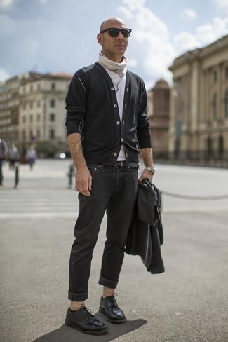 How to wear: black leather biker jacket, black cardigan, white crew-neck t-shirt, black jeans