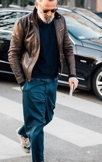 Men's Looks & Outfits: What To Wear In Chill Weather: A dark brown leather biker jacket and teal chinos make for the ultimate laid-back outfit for any modern man. Complete this ensemble with beige athletic shoes to loosen things up.