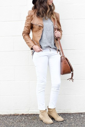How to wear: tan leather biker jacket, grey crew-neck sweater, white jeans, beige suede ankle boots