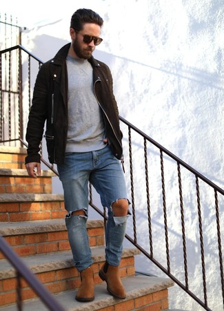 How to wear: dark brown suede biker jacket, grey crew-neck sweater, blue ripped jeans, tobacco suede chelsea boots