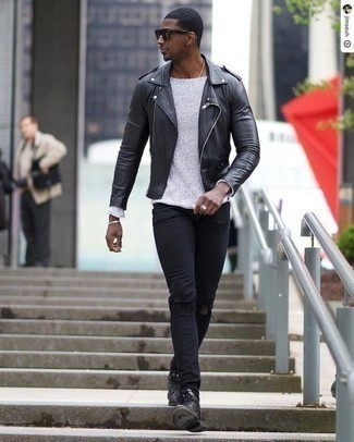 How to Wear a White Crew-neck Sweater For Men: This pairing of a white crew-neck sweater and black ripped jeans looks put together and instantly makes any gentleman look cool. Let's make a bit more effort now and add black leather casual boots to the mix.