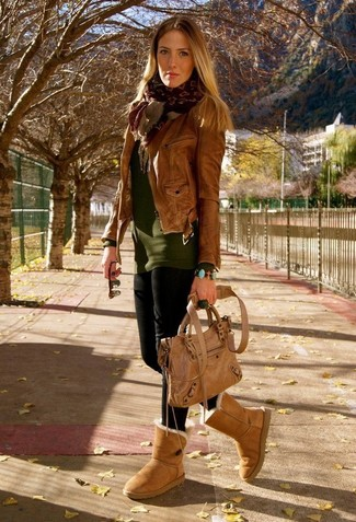 How to wear: brown leather biker jacket, olive crew-neck sweater, black leggings, tan uggs