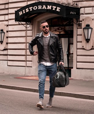 How to wear: black leather biker jacket, charcoal crew-neck sweater, white long sleeve shirt, blue ripped jeans