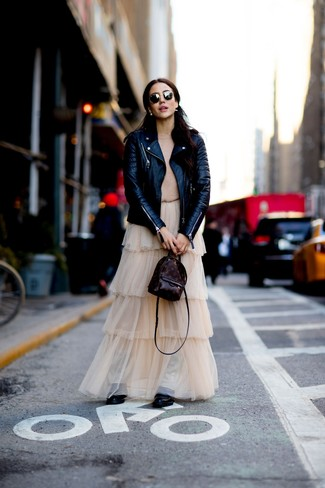 How to wear: black leather biker jacket, tan crew-neck sweater, beige tulle maxi skirt, black leather lace-up flat boots
