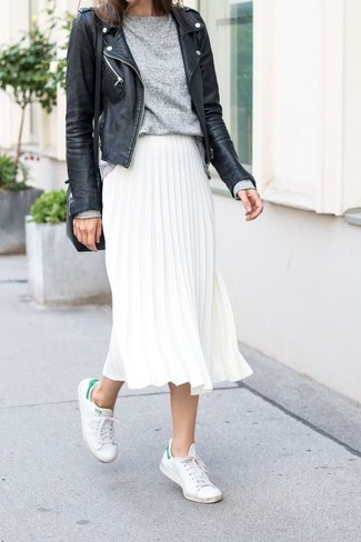 How to wear: black leather biker jacket, grey crew-neck sweater, white pleated midi skirt, white low top sneakers